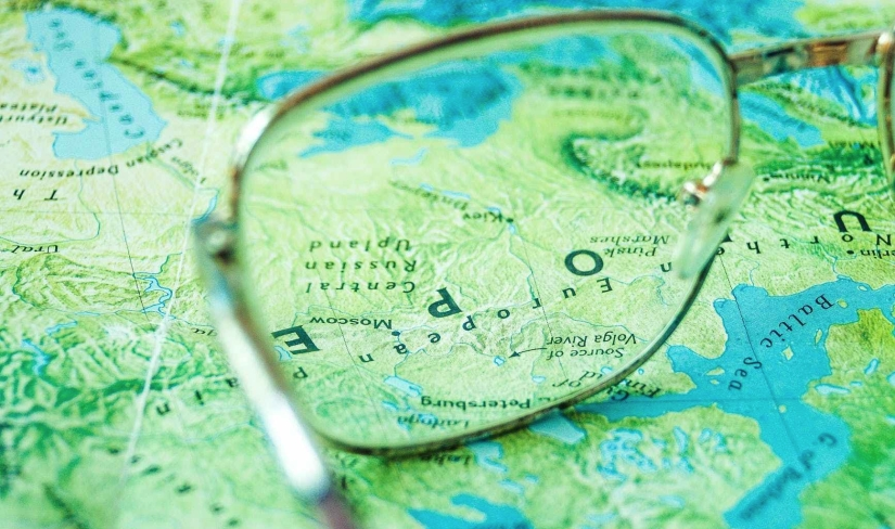 Glasses set on top of a map.